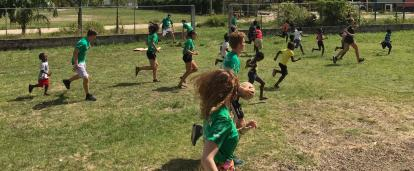 A group of volunteers in Belize run a sports coaching class at a local school.